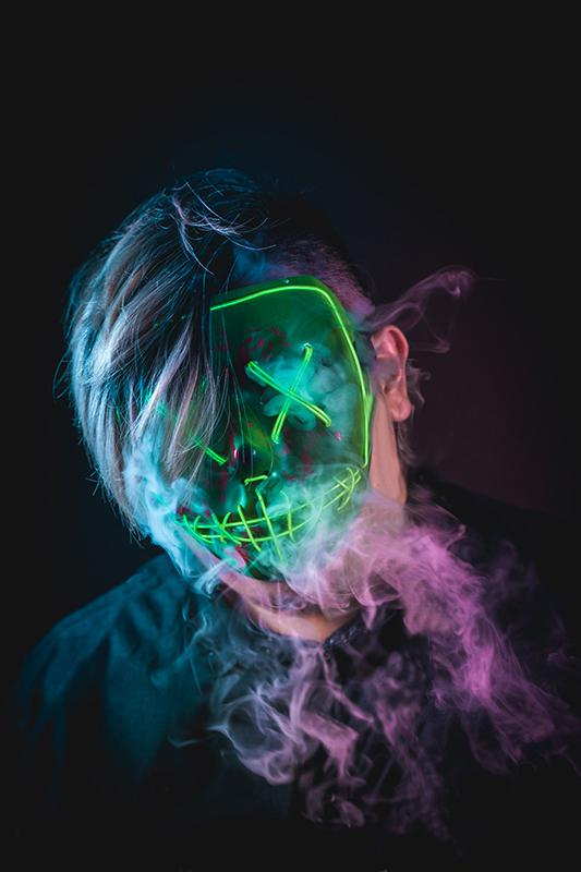 Vaping while wearing led mask photoshoot