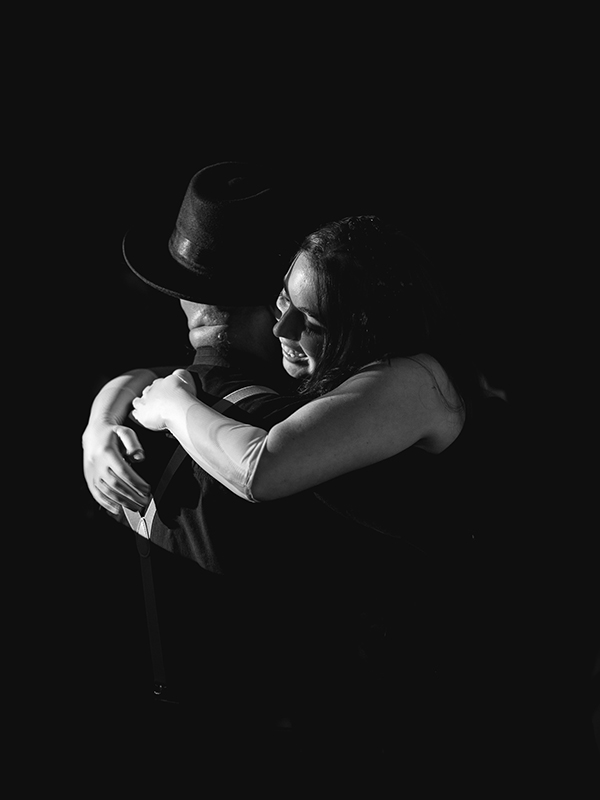 couple hugging on 80th birthday party